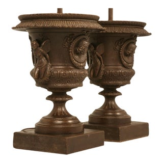 Magnificent Pair of Italian Iron Cherub Urns Fitted as Lamps For Sale