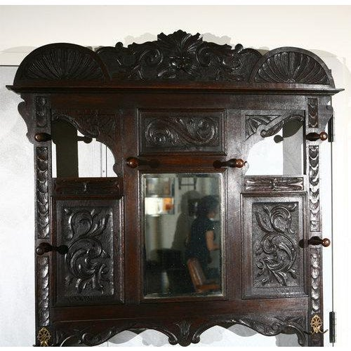 A good size English hall stand, carved oak, circa 1880. Space for lots of coats, hats, canes and umbrellas as well as...