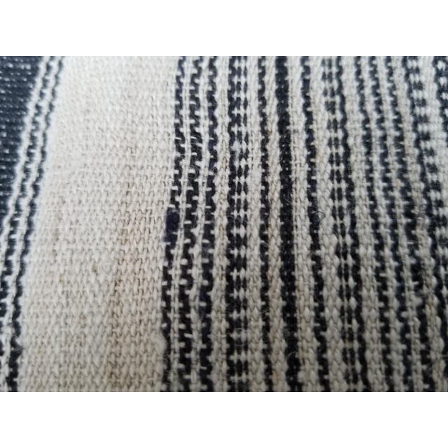A tribal textile that was originally a complete 1000 pleat skirt worn by the Dong hill tribe people of China. Spun and...