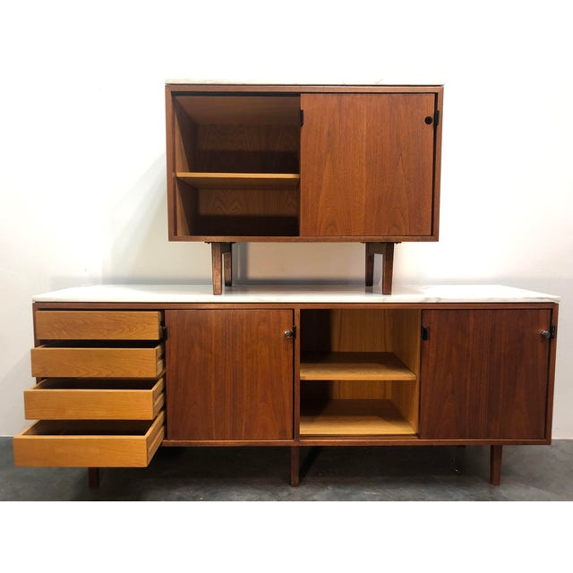 Height of the era cabinet set designed by Florence Knoll for Knoll Associates. These professionally restored credenzas are...