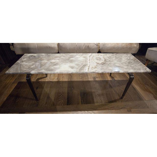 A custom coffee table with dark wood legs and a sleek onyx top, design by San Francisco designer Will Wick. Onyx Top is...