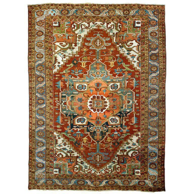 "An antique Serapi rug with a center medallion and intricate design. Measurement: 9'8"" x 13'4""."
