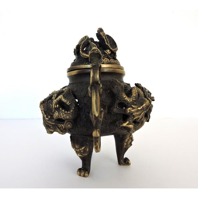 Vintage Chinese brass incense burner or censer on tripod legs, with removable top. Reticulated body decorated throughout...
