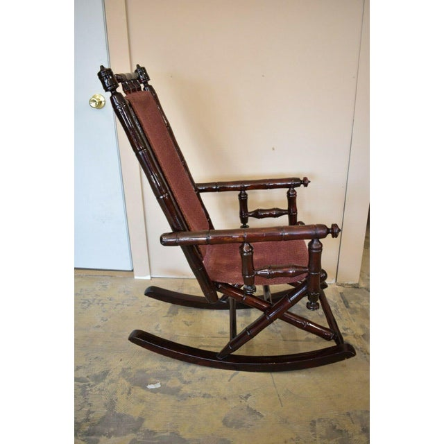 Vintage Faux Bamboo Rocking Chair With Mahogany Finish and Maroon Upholstery For Sale - Image 9 of 10