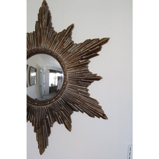 "Circa 1960s, resin frame convex sunburst mirror with gilt finish. Stunning rays of alternating length. Ready to hang! 23""..."