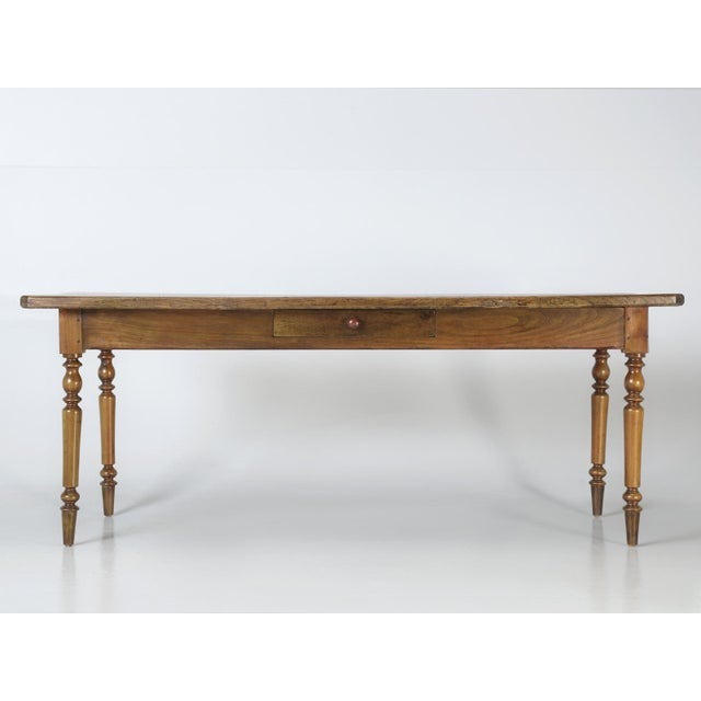 Antique country French oak farm table, with a unique pass-through drawer. This particular antique country French farm...
