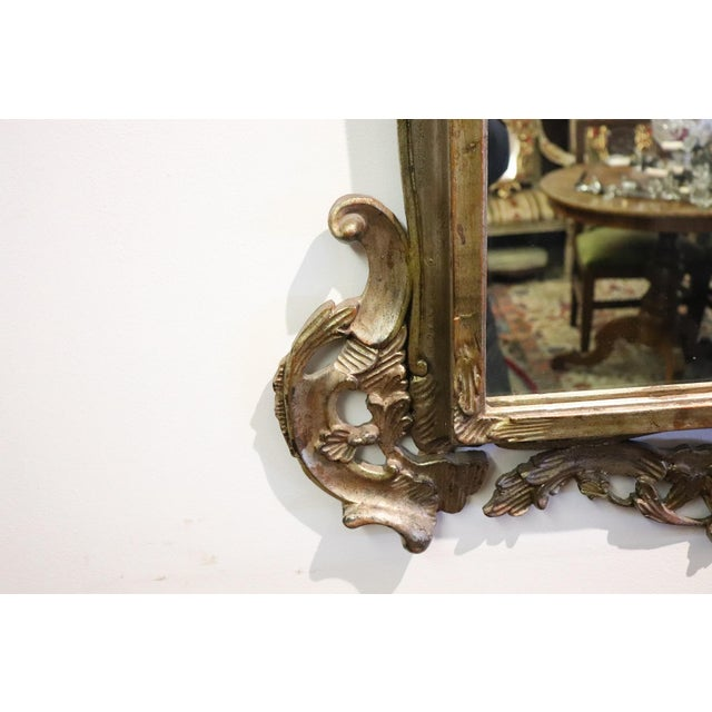 Large luxury antique carved wood wall mirror 1950s with refined decoration in silver. Very rich work in Louis XV style...