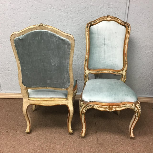 A great and hard to find pair of 18th Century Venetian painted chairs. The frames have are decorated with colorful floral...