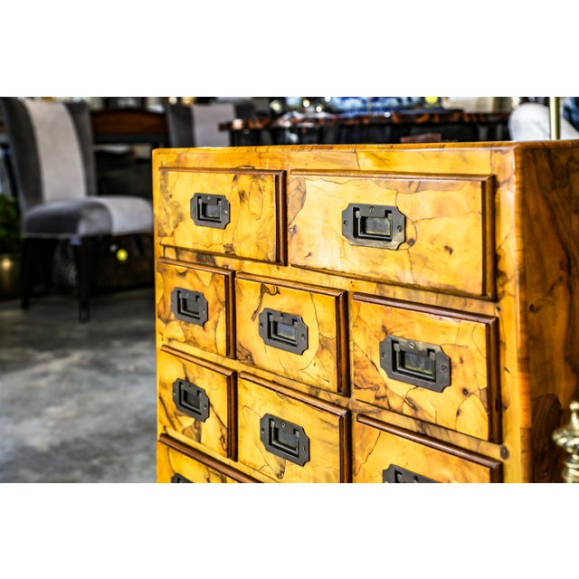 Mid century olive wood, 9-drawer chest. Made in the mid 20th century.