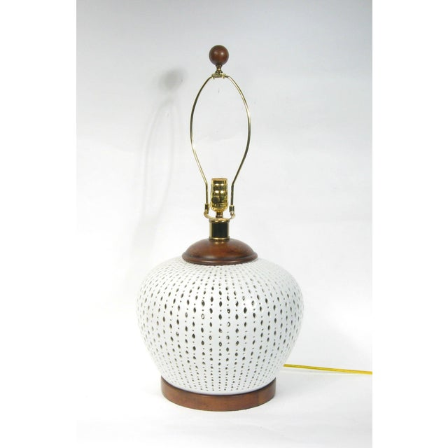 Ralph Lauren Camille Table lamp in porcelain with hand-cut piercings. Solid wood accents including finial. Three-way...