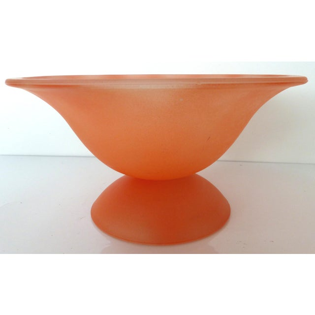 A large handblown Murano Glass footed fruit bowl with a frosted peach color finish. Retains the original Murano label....