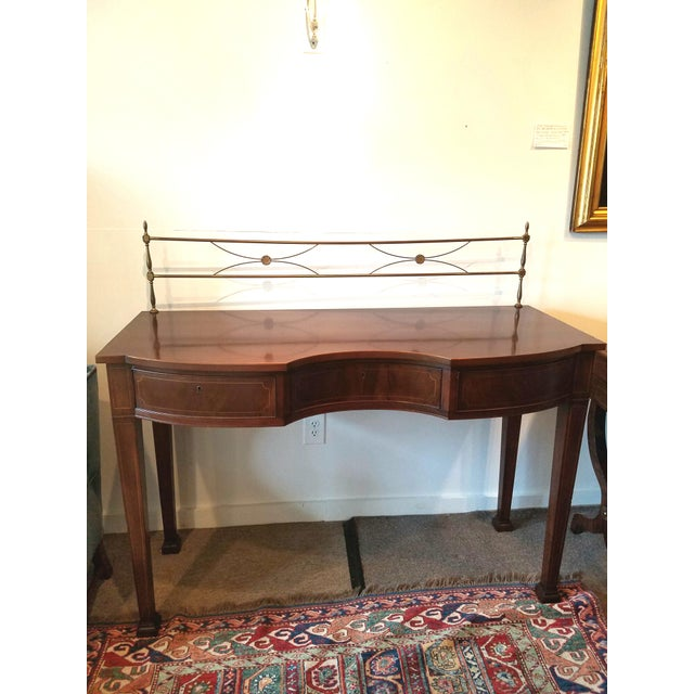 Wonderful small size this elegant sideboard was made in the 30's or 40's. Serpentine front with three drawers. Satinwood...