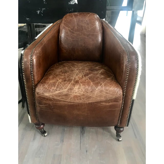 This Regina Andrew contemporary leather club chair with cowhide upholstered back is elegant yet casual. The leather is...