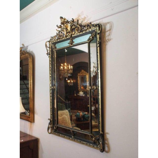 Fine antique French gilt wood and ebonized mirror, Circa 1850.