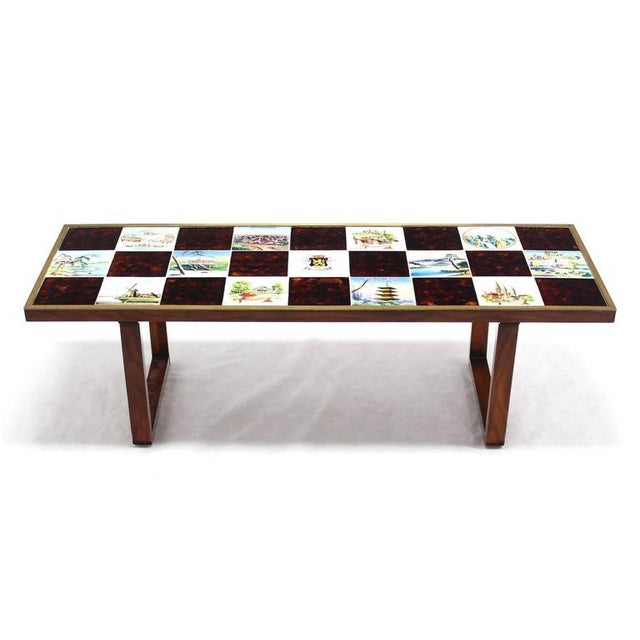 """Very nice art tile coffee table top frame in brass """"frame"""" banding around the edge."""