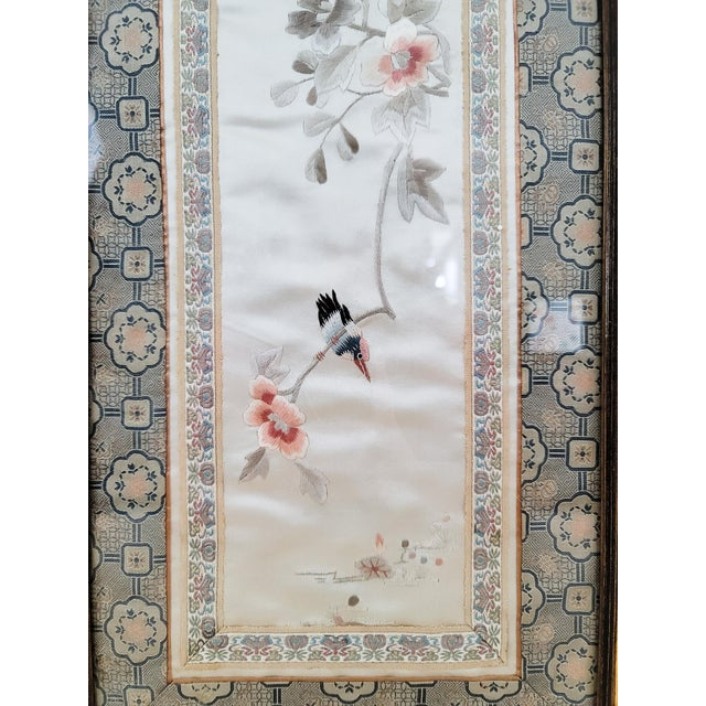 A beautifully framed piece of mid-century chinoiserie embroidery. Bamboo, floral, and bird motifs are expertly rendered in...
