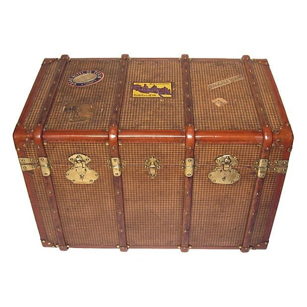 This is a beautiful Early 20th Century French bentwood and painted canvas steamer trunk. It is trimmed with leather,...