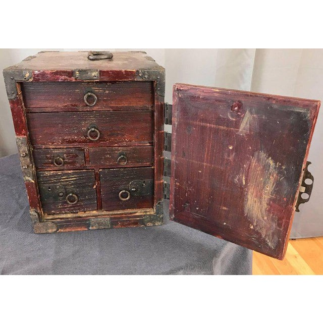 A compact and portable antique Chinese seaman's or sailor's chest with drawers, locks, and rare original key. Handsomely...