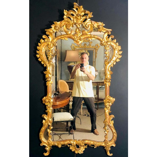 19th century gilt mirror wall or console mirror. A stunning wall or console mirror having a spectacular gilt gold wooden...