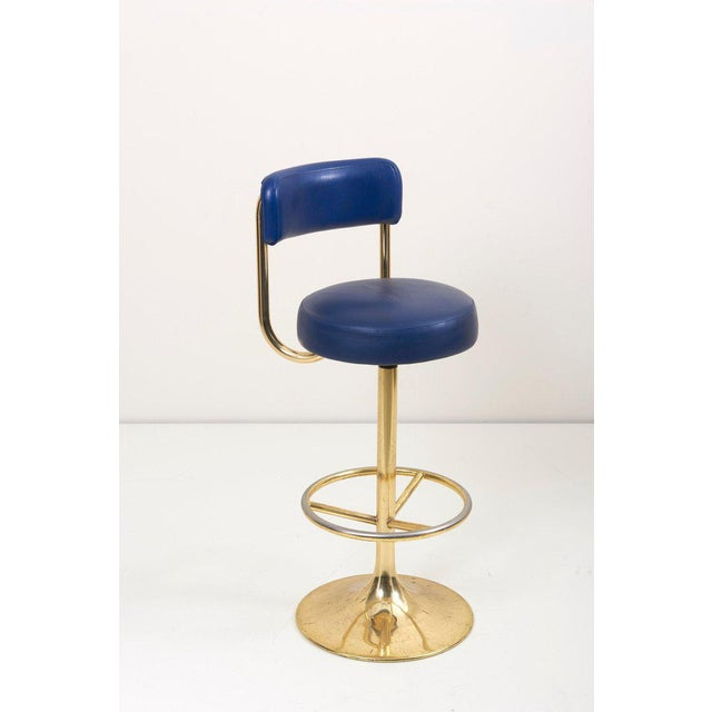 Wonderful gold-plated and original faux leather barstools. The stools are very comfortable. They are designed by Börje...
