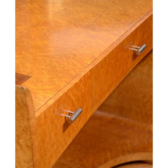 A vintage Art Deco vanity table in bird's-eye maple with inlaid geometric details. The mirror pivots (the reverse is...