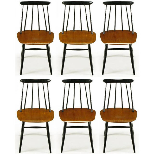 Set of six Ilmari Tapiovaara bent teak wood seat Fanett dining chairs. Black lacquered spindle back, legs and stretchers....