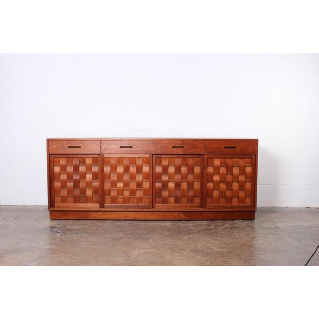 A bleached walnut woven front credenza designed by Edward Wormley for Dunbar.
