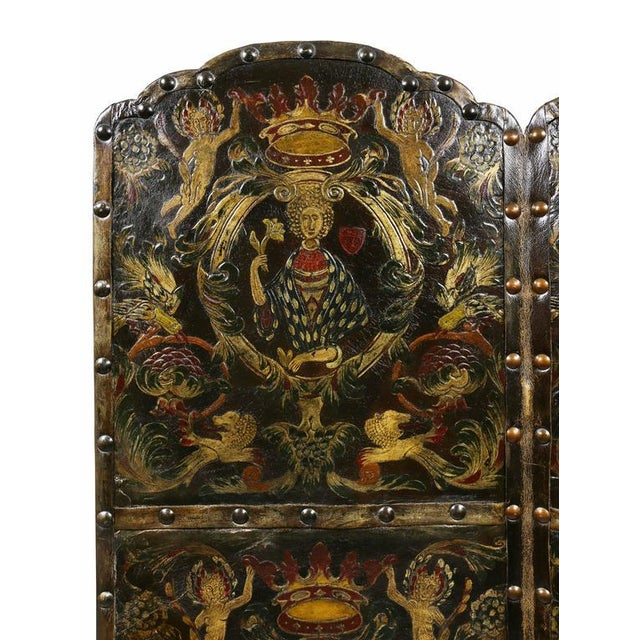 Four panel screen with scenes of classical design with brass tacks.