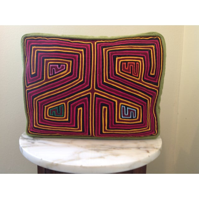 This cushion is crafted of authentic vintage molas made by the women of the Kuna Indian tribe of Panama. The Kuna indians...