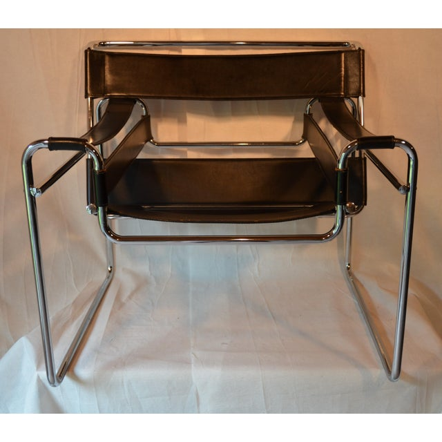 A classic Wassily armchair in the style of Marcel Breuer in chrome and black leather. The leather is very heavy/thick with...