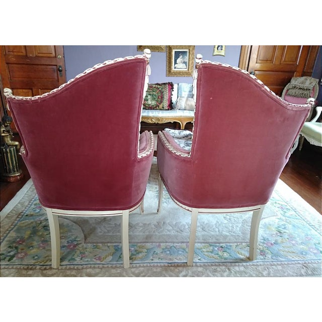 Pair of vintage French Provincial fireside accent chairs. Gorgeous carved wood frames that are rope and tassel design....