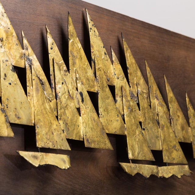 A Rare Brass Metal Sailboat Wall Sculpture by Peter Pepper Mounted on a Wooden Backdrop 1960s
