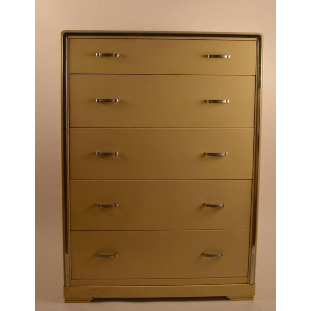 Nice high boy chest by Bel Geddes for Simmons. Pale yellow case with bright chrome trim, and metal pulls. Five deep...