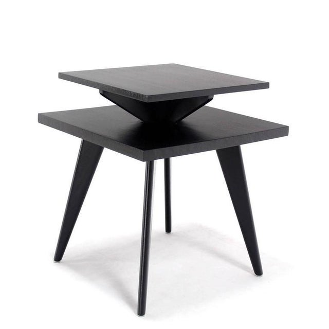 Nice Mid-Century Modern black lacquer side table. Heavy and solid design construction.