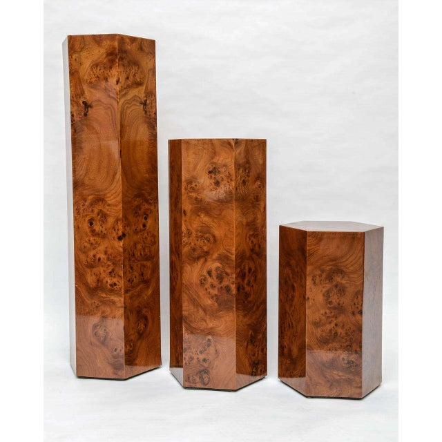 """Expertly made pedestals in burl wood. Continuous wood pattern on all three pedestals. Heights are 18.25"""", 28.25"""" and 40.25."""""""