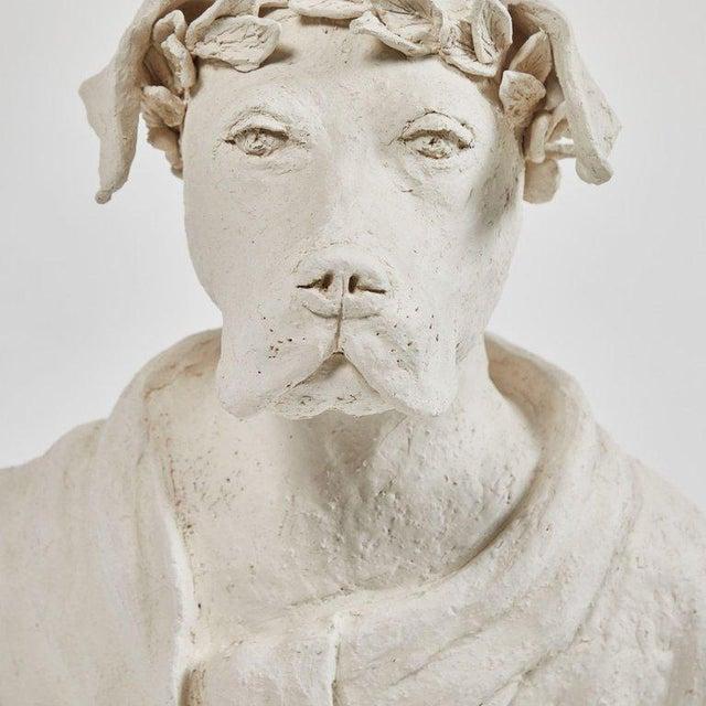 A dog sculpture in plaster, originating in France, circa 2010.