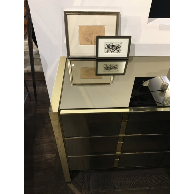 A 1970s Ello bronze and polished metal dresser with nine drawers. There are some dings and a small amount of pitting on...
