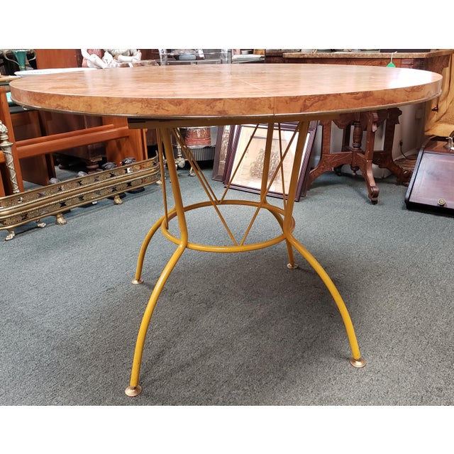 Up for sale is a Mid Century Faux Burlwood Yellow Enamel Painted Metal Dinette Set! The set comes with four metal, faux...