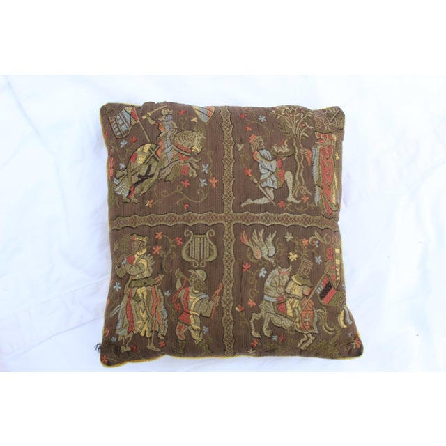 Renaissance style support pillow with embroidered silk knights and madrigals and a dark gold ribbed velvet or velour back....
