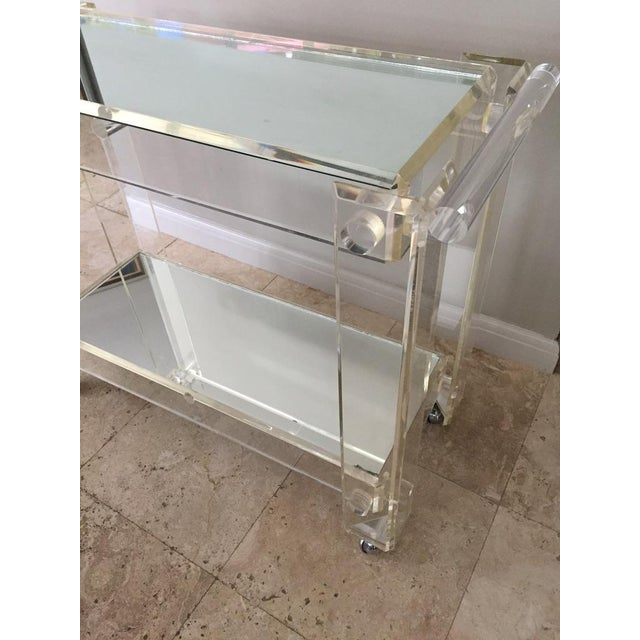 """Classic 70s mid-century modern rolling bar cart made of lucite: The vertical and horizontal supports are thick 1/2"""" lucite..."""