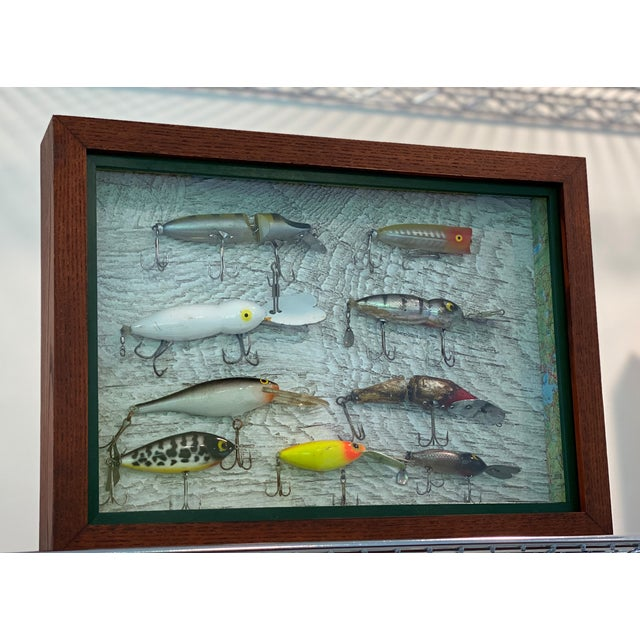 Set of four hand-crafted tackle shadow boxes. Wooden boxes are custom stained and finished brown, with a dark green fillet...
