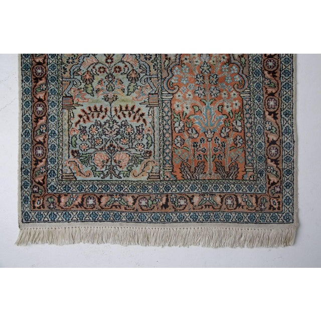 Luxurious Persian pale blue field silk runner with fringing either end. Displaying central pastel colored block panels...