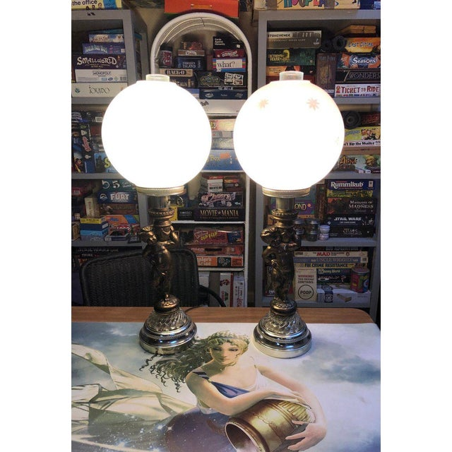 """Vintage double globe lamps with cherub bases. Outer globe is 9"""" in diameter. Work great! Minor patina and wear to frost as..."""