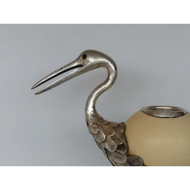 Offered to you is this Anthony Redmile silverplate crane, this item exemplifies Redmile's work. Using an ostrich egg as...