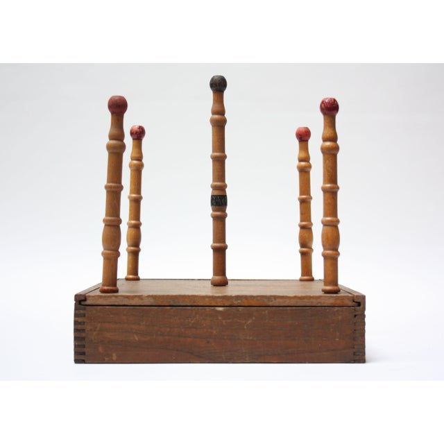 Early 20th Century Ring Toss composed of a game board, which doubles as a storage box for the accessories when not in...
