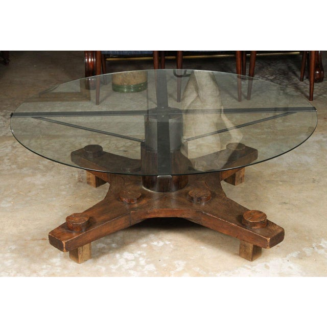 Round glass top coffee table made from English ship port part with metal base.