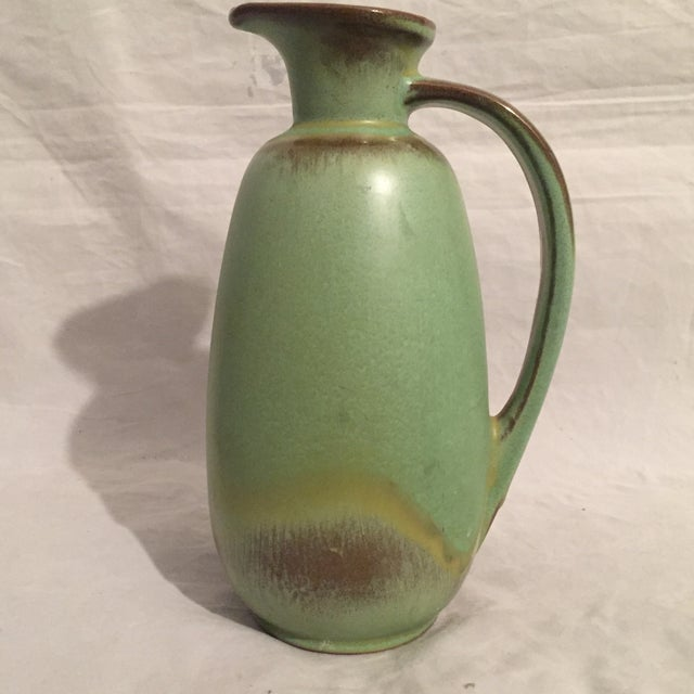 """Vintage Frankoma pitcher with unique handle shape. Colored green and brown and is circa 1960's. Signed on bottom """"FRANKOMA..."""