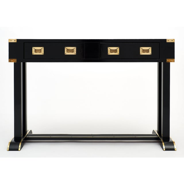 A rare ebonized and French polished vintage Italian campaign desk with gilt brass trims throughout. The original brass...
