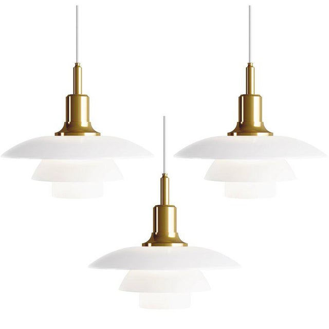 Poul Henningsen brass and glass PH 3½-3 pendant for Louis Poulsen. Executed in white opal glass and a brass, chrome or...