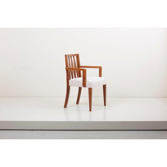 Set consists of 6 armless chairs and 2 armchairs. Newly restored and upholstered with fabric by Kvadrat.